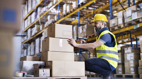 Warehouse worker scanning packages